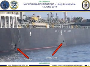 A handout powerpoint slide made available on 14 June 2019 by US Central Command shows damage from an explosion (left) and an object claimed by the US military to likely be a limpet mine on the hull of the M/V Kokuka Courageous in the Gulf of Oman, 13 June 2019.