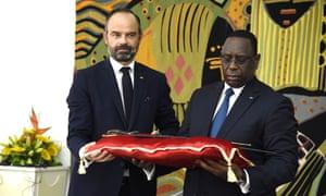 Senegal's president Macky Sall receiving the sword of Omar Saidou Tall from the French prime minister Edouard Philippe, Dakar, November 2019.