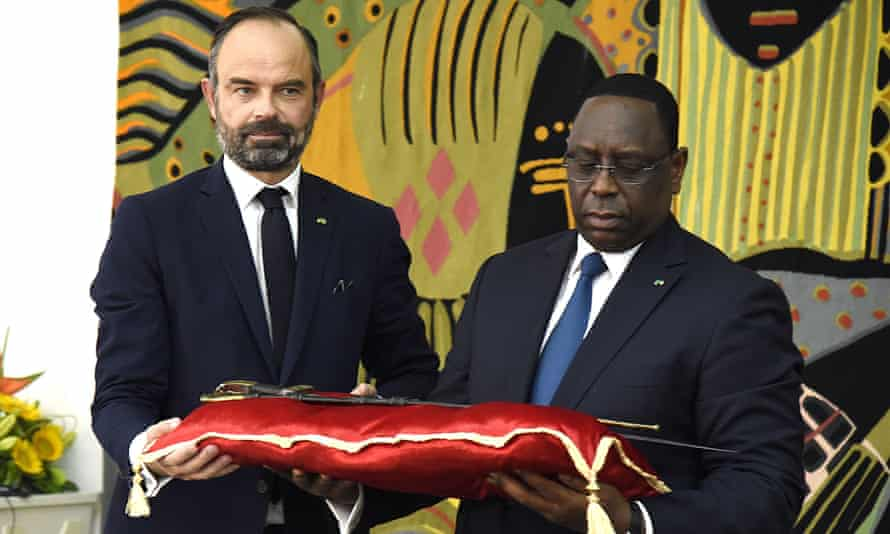 Senegal president Macky Sall, right, receiving the sword that belonged to Omar Saidou Tall from French prime minister Édouard Philippe in 2019.