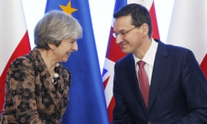Theresa May and Mateusz Morawiecki shake hands during a press conference after signing a treaty on defence and security cooperation