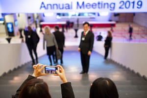 People take pictures in the congress centre as the 49th annual meeting of the World Economic Forum, WEF, in Davos begins.
