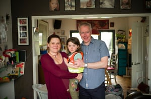 Rosie Woods with her husband, Martin Donohue, and daughter.