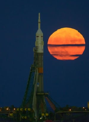The supermoon rises behind the Soyuz rocket at the Baikonur Cosmodrome launch pad in Kazakhstan, Monday, Nov. 14, 2016. NASA astronaut Peggy Whitson, Russian cosmonaut Oleg Novitskiy of Roscosmos, and ESA astronaut Thomas Pesquet will launch from the Baikonur Cosmodrome in Kazakhstan the morning of November 18 (Kazakh time.) All three will spend approximately six months on the orbital complex. A supermoon occurs when the moon's orbit is closest (perigee) to Earth. Photo Credit: (NASA/Bill Ingalls)