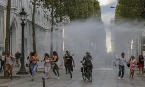 Riot police use water cannon to disperse French demonstrators as protests against vaccines and the government's new health pass requirement continue for the second week in Paris, France. Nearly 168 rallies took place across the country with 160,000 protesters taking to the streets, according to the Interior Ministry.