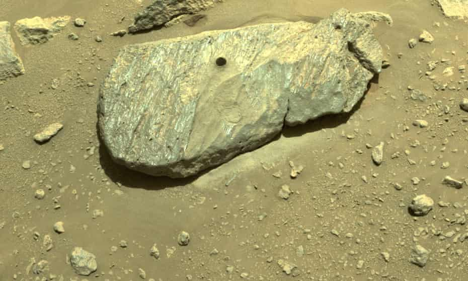 Nasa image shows the hole drilled by the Perseverance rover during its second sample collection.