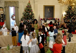 first lady michelle obama welcomes children of military families to holiday festivities at the white house