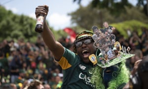 South Africa fans celebrate at the Pirates Rugby Club in Johannesburg