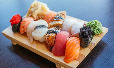 Close-up of sushi set on wooden board