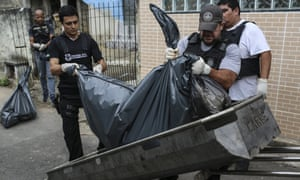 Civil police remove the corpses of two women murdered in Vitória, where the militarised police are on strike.