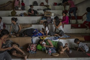 Residents who fled the eruption recover in an evacuation centre in Santo Tomas, Batangas province