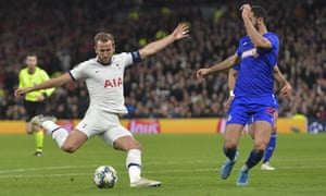 Harry Kane shoots during the Champions League match between Tottenham Hotspur and Olympiakos