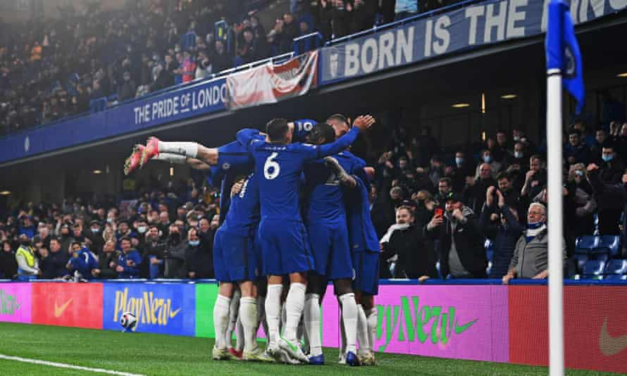 Jorginho is mobbed by teammates after scoring Chelsea's second against Leicester.