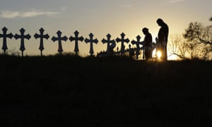 Kenneth and Irene Hernandez pay their respects as they visit a makeshift memorial with crosses placed near the scene of a shooting at the First Baptist Church of Sutherland Springs.