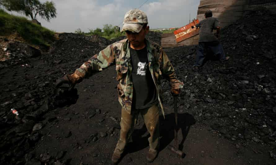 Coal miners work at an artisanal mine in Nueva Rosita on 31 July 2008.
