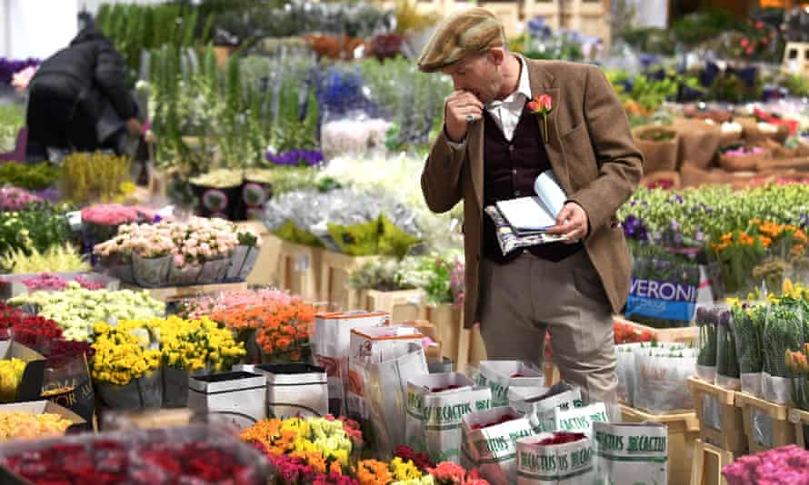 A trader at the flower market at New Covent Garden Market.