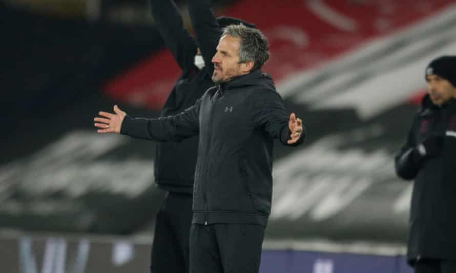 The Southampton assistant manager, Richard Kitzbichler, on the touchline with his arms raised to his side