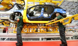 Workers assemble a Range Rover Sport at Jaguar Land Rover's manufacturing plant in Solihull