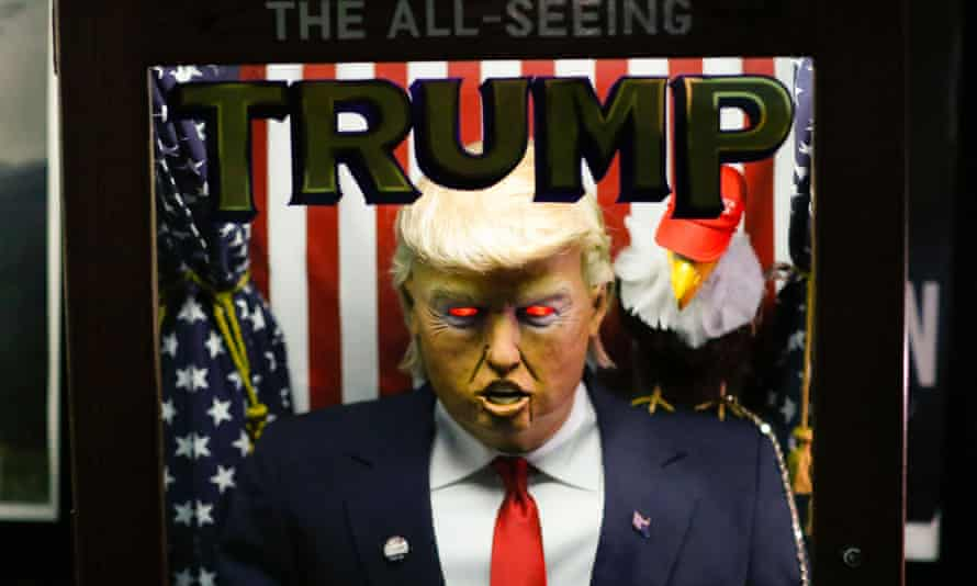 Art installation All-Seeing Trump outside the IFC Theater showing Michale Moore in TrumpLand
