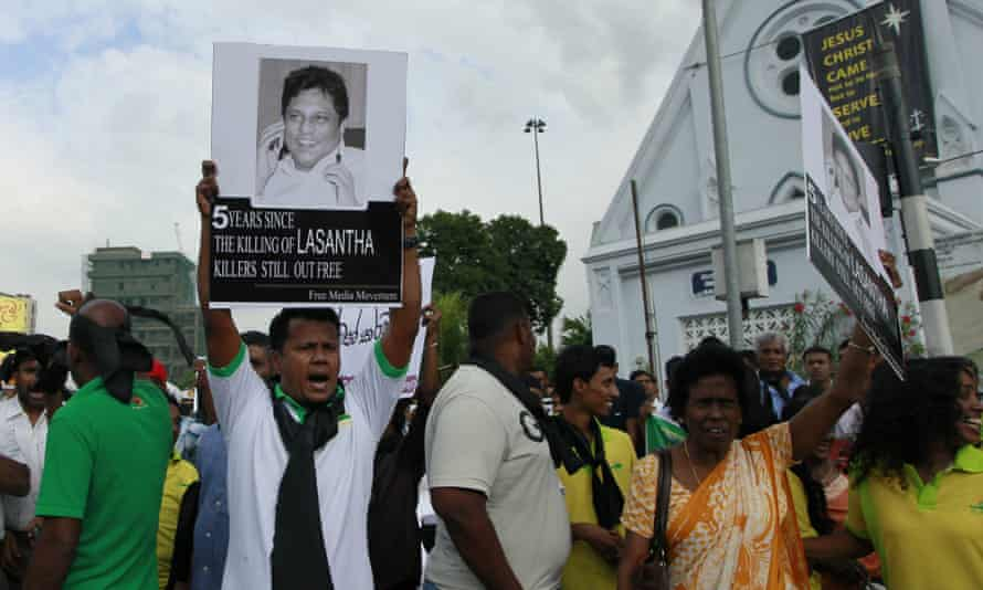 A protester holds a portrait of Lasantha Wickrematunge, who was assassinated by gunmen on motorcyles as he went to work in Colombo, Sri Lanka.