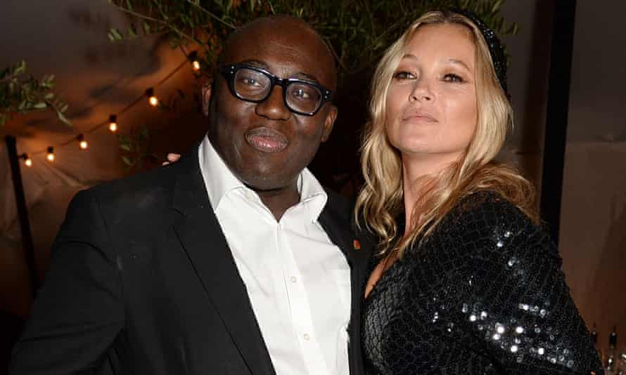 Edward Enninful celebrating the December issue of British Vogue in London, with Kate Moss.