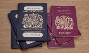 Old style dark blue British Passports alongside EU style red passports
