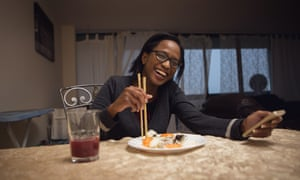 Christine Odunlami has a takeout sushi dinner at her home in Toronto, Canada.