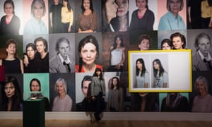 Gillian Wearing poses in front of the wall of images