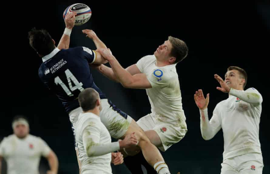 Owen Farrell is beaten to a high ball by Sean Maitland during England's defeat to Scotland in their opening game of the 2021 Six Nations.