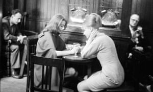 Mandy Rice-Davies, right, and Christine Keeler captured in a London pub by Doreen Spooner in their lunch break during the trial of Stephen Ward in 1963.