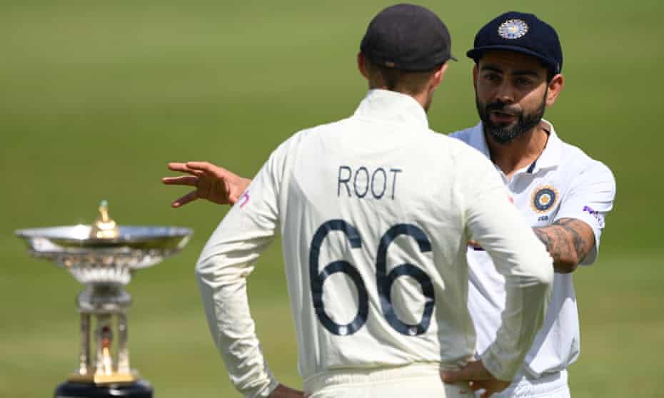 England's Joe Root and India's Virat Kohli chat next to the Pataudi Trophy at Trent Bridge.