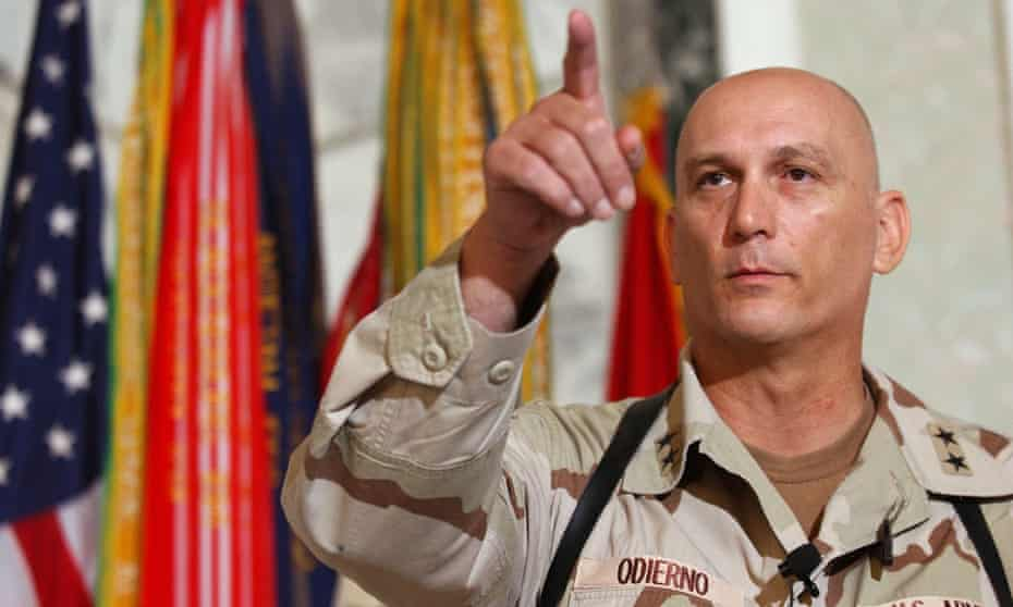 Gen Raymond Odierno gestures during a news conference in Tikrit, Iraq.
