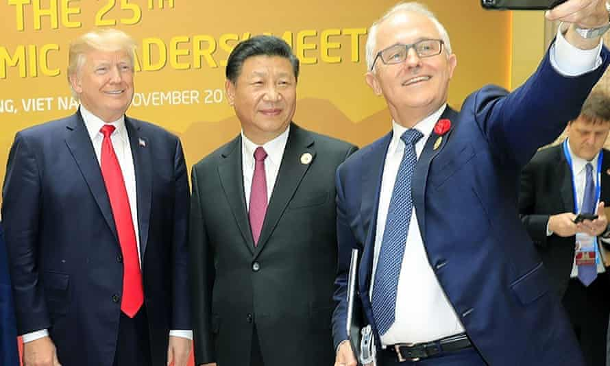 US president Donald Trump (left), China's President Xi Jinping and Australian prime minister Malcolm Turnbull (right) at the APEC Economic Leaders' Meeting, 11 November 2017
