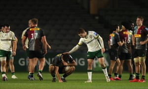London Irish's Paddy Jackson (right) places his hand on Harlequins' Archie White's back to comfort him after the final whistle.
