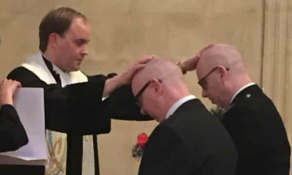 The Rev Joost Röselaers lays his hands on John and John during their marriage ceremony