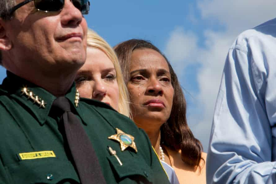 Officials hold a press conference on scene at the Marjory Stoneman Douglas high school on 15 February.