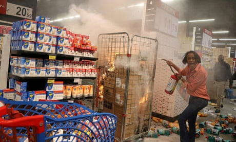 Violence erupts in Brazil after a black man is beaten to death outside supermarket – video
