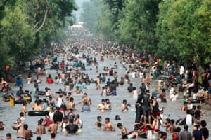 Residents of Lahore, Pakistan, cool off in a canal during a heatwave, 21 June 2015