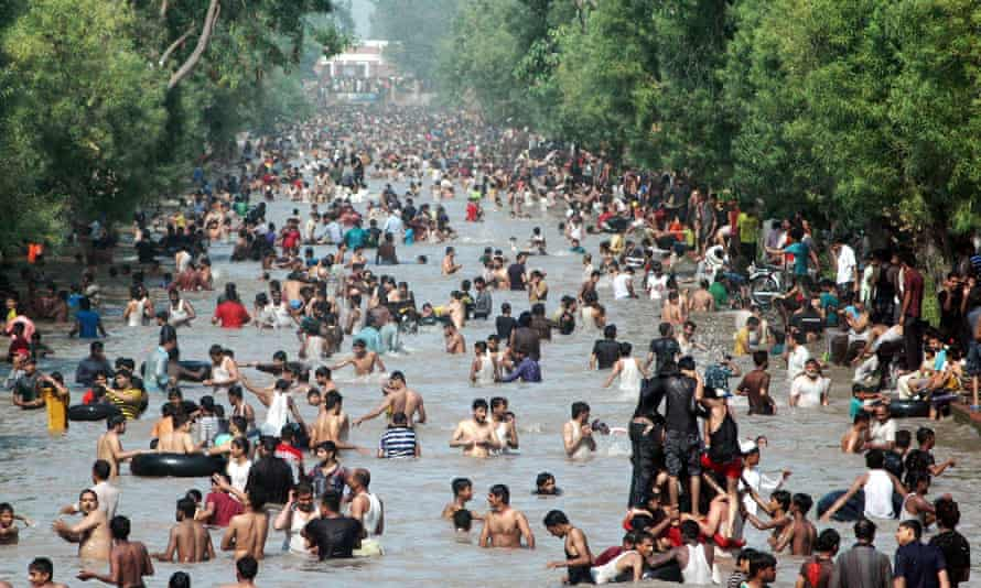 Pakistanis cool themselves off in a canal during the heatwave in eastern Pakistan's Lahore in June 2015.