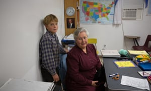 Fred Richter, 11, and his mother, Norma Richter, in one of their home built homeschool classrooms.