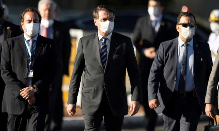 Brazilian president Jair Bolsonaro, centre, and his ministers arriving in Brasilia.
