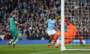 Raheem Sterling scores his second and Manchester City's third goal of the game.