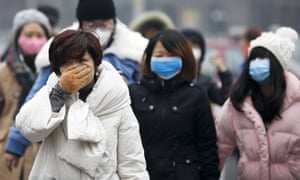 A woman covers her face