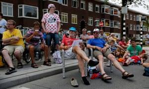 Spectators watch the riders on the big screen in Utrecht.