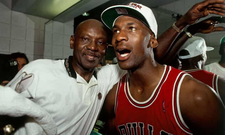 Michael Jordan celebrates winning his third title with the Chicago Bulls, alongside his father James. James was killed a month later