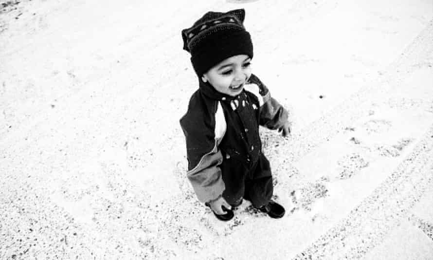 Yazen, from Iraq, sees snow for the first time.