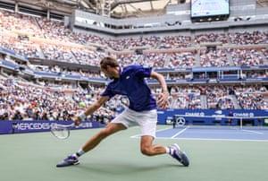 Daniil Medvedev of Russia returns the ball against Novak Djokovic.