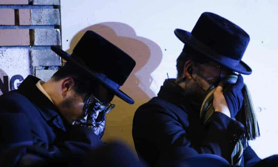 Orthodox Jewish men mourn during the funeral service of Mindel Ferencz, who was killed in a kosher market that was the site of a gun battle in Jersey City, New Jersey, on 11 December.