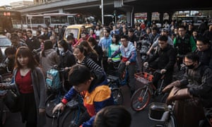 A check on runaway growth … Beijing's commuters during rush hour.