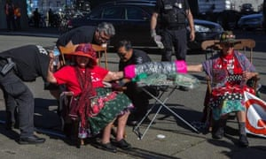 Seattle police officers cut chains off two of the Raging Grannies during a protest in front of the Seattle port on Tuesday.