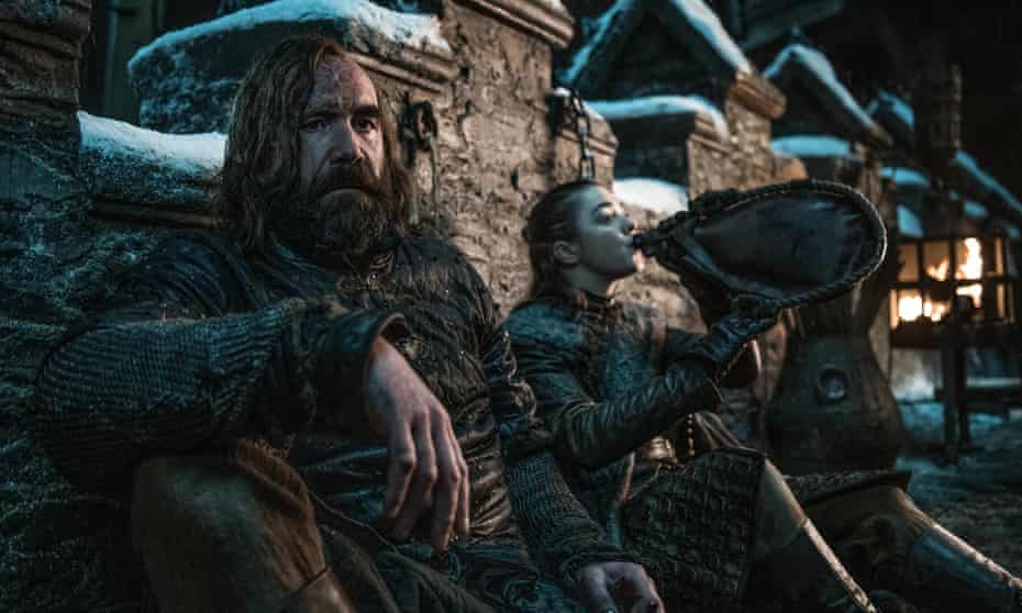 Frenemies reunited ... The Hound (Rory McCann) and Arya (Maisie Williams) share a drink.